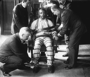 black man strapped to an electric chair